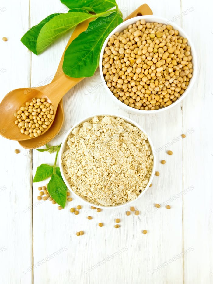 Flour soy with soybeans and leaf on light board top