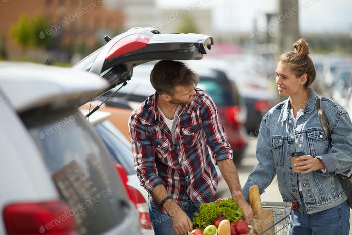 Couple Packing Groceries into Car