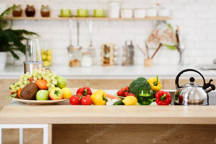 Fresh Vegetables And Fruits On Kitchen Table