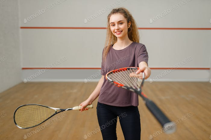 Female player gives squash racket