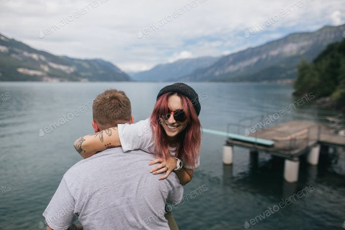 Man Carrying Happy Young Woman