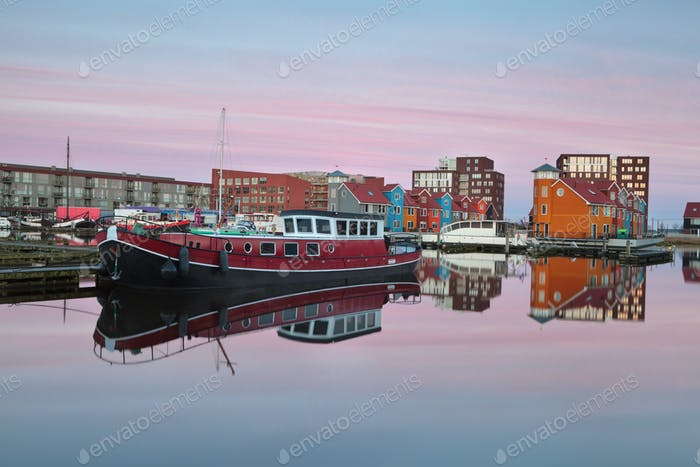 ship on Reitdiephaven harbor at sunrise