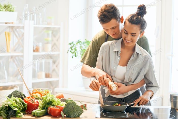 loving couple is preparing the proper meal