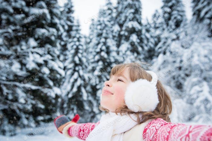 Child in winter park