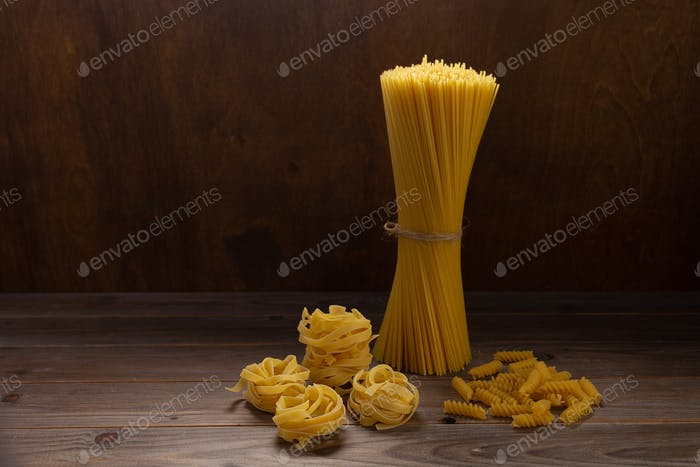 Pasta collection food on wooden table background front view