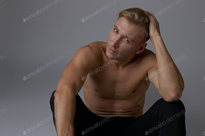 Portrait sitting man naked torso posing