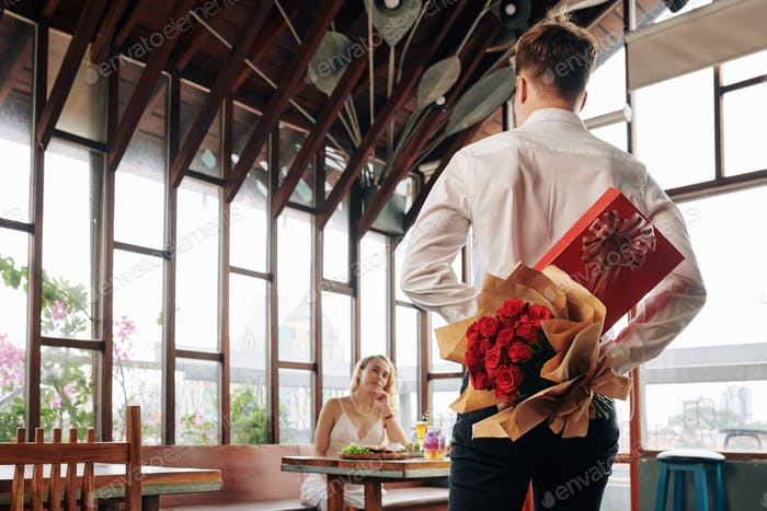 Man Showing Up For Date With Gifts