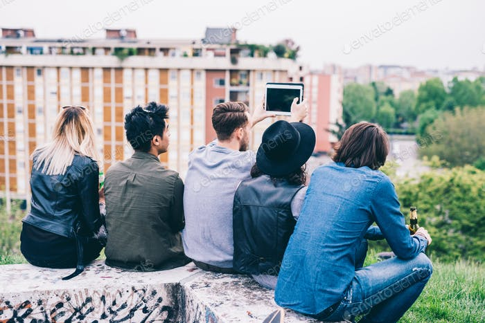 Group of young multiethnic friends taking selfie