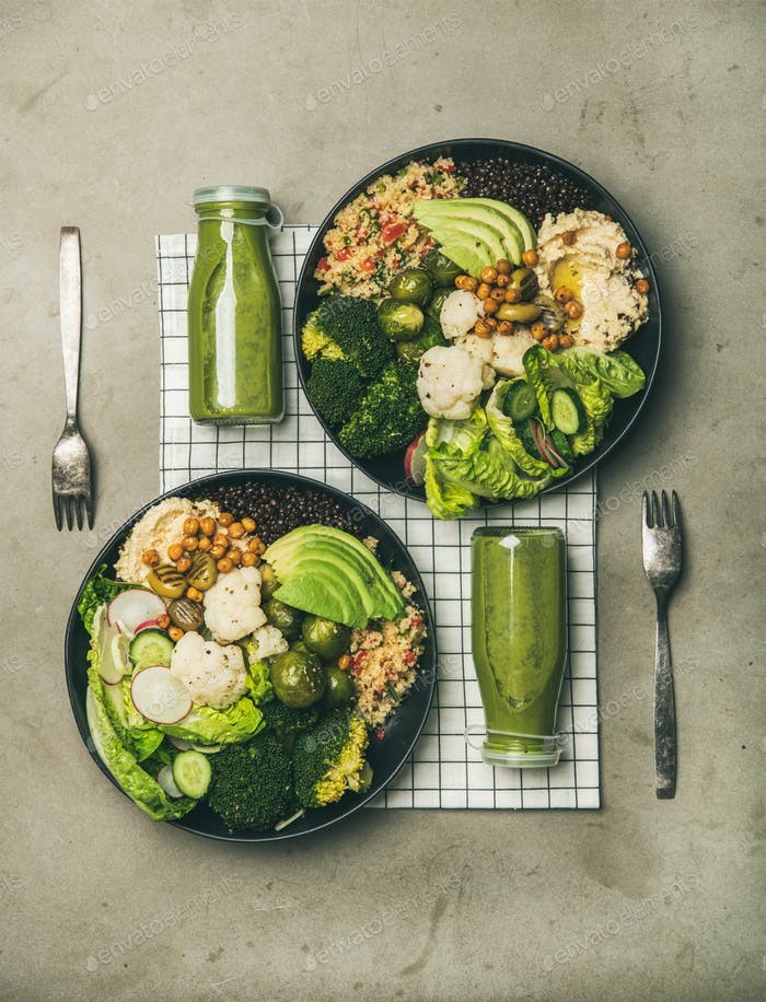 Flat-lay of healthy dinner with superbowls and green smoothies