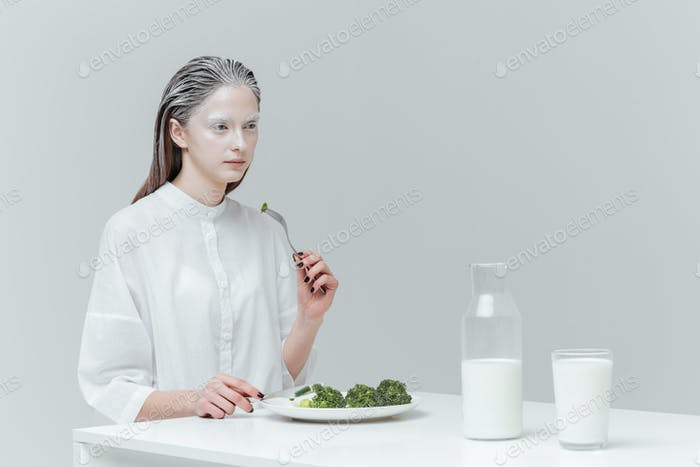 Woman having lunch at the table