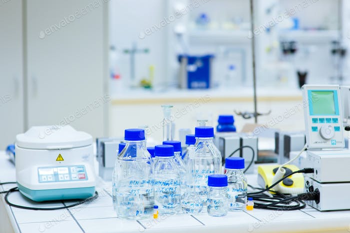female researcher carrying out research experiments in a chemist