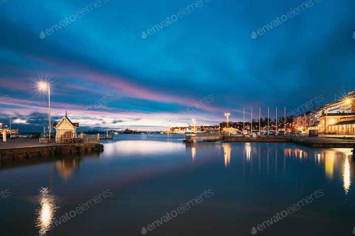 Helsinki, Finland. Landscape With City Pier, Jetty At Winter Sunrise Sunset Time. Blue Sky Reflected