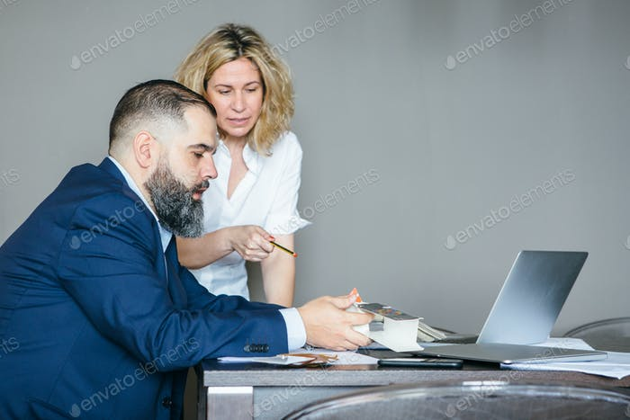 Woman helping man to choose color