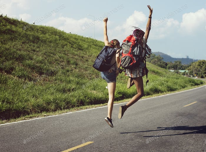 Diverse Backpacker Women Jumping The Street