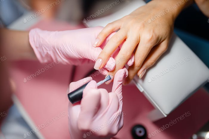 Cosmetology salon, manicure, varnish application