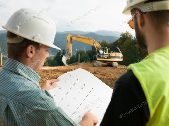 Thumbnail for contractors reading construction plans