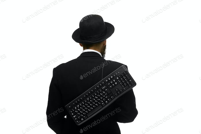 mime as a businessman holdinga keyboard behind