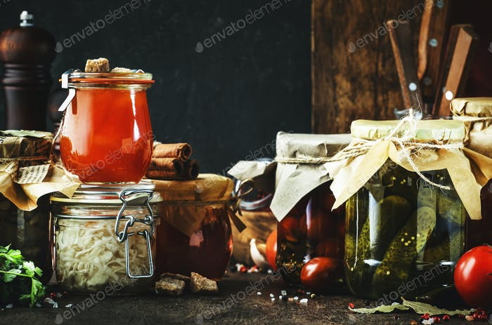 Organic vegetables and fruits in jars with spice and herbs