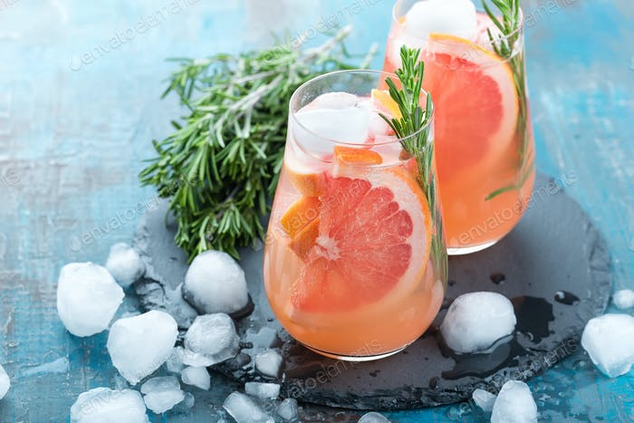 Grapefruit and thyme gin cocktail, refreshing drink with ice