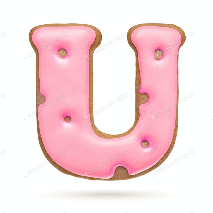 Capital letter U. Pink gingerbread biscuit isolated on white.