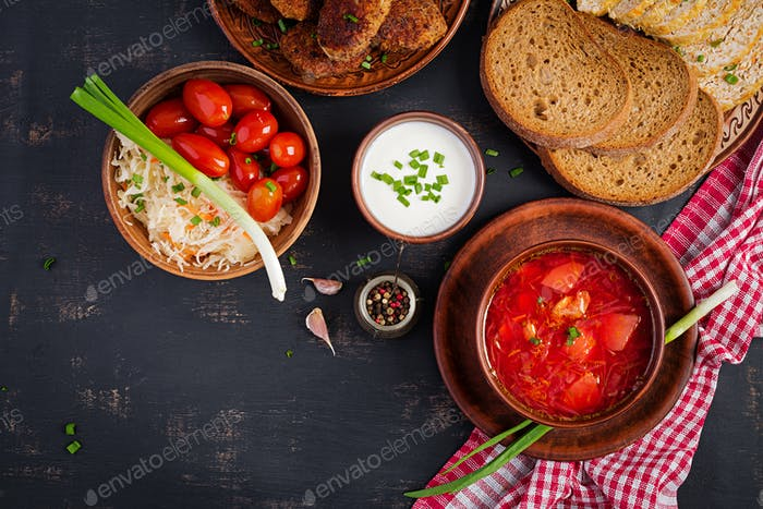 Traditional Ukrainian Russian borscht or red soup on the  bowl. Top view