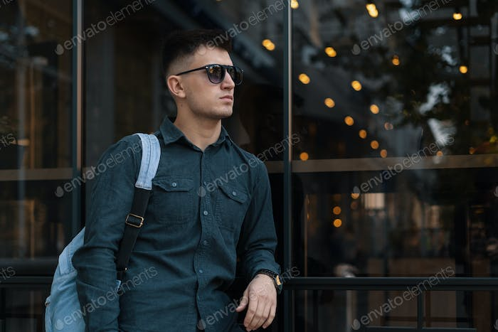 Modern young male with sunglasses and backpack