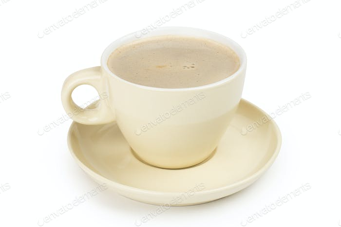 small white cup of cappuccino coffee on light background