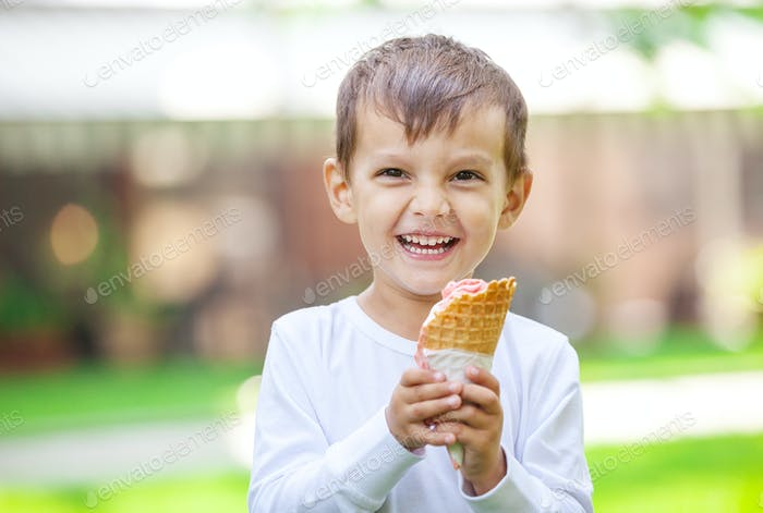 Portrait of young boy eating ice cream outdoors