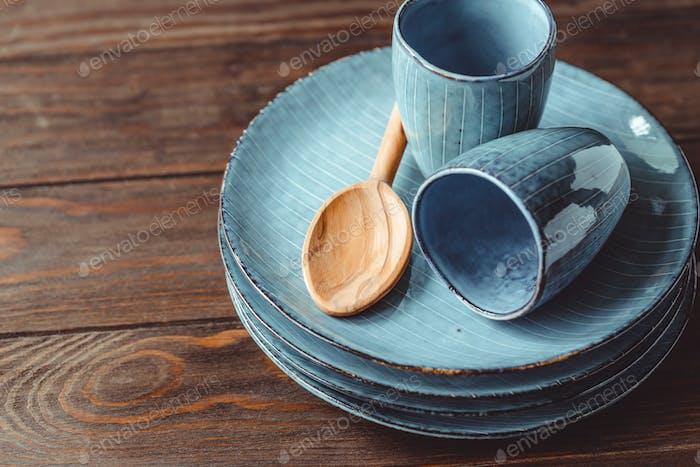 Handmade blue set of ceramic tableware. Espresso cups and plates.