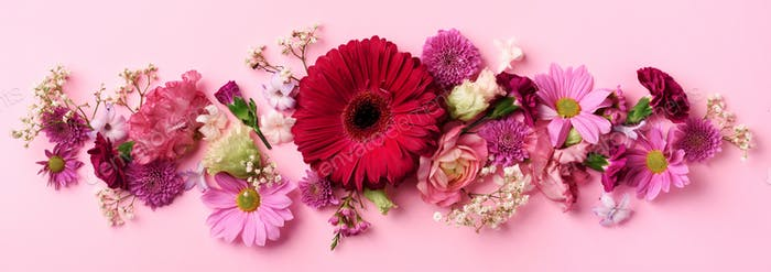 Spring composition of pink flowers on punchy pastel background with copy space. Creative layout