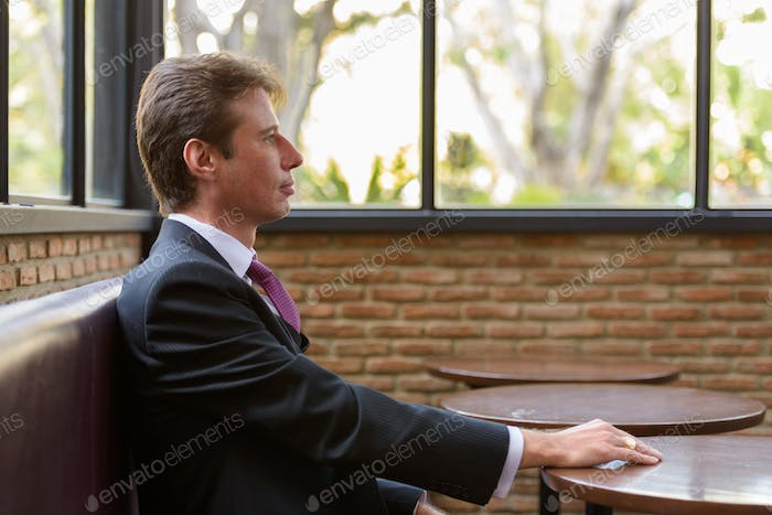 Profile view of businessman sitting in coffee shop