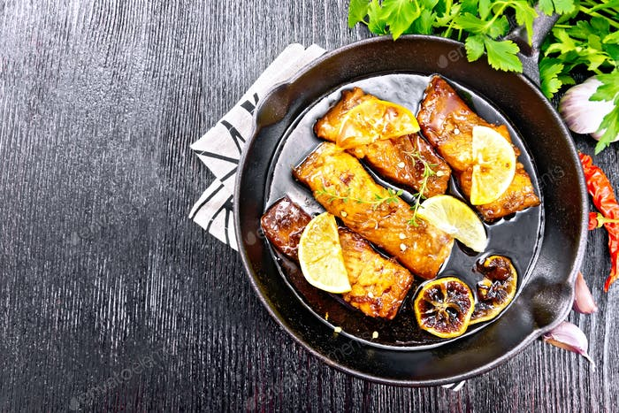 Salmon with sauce in pan on board top