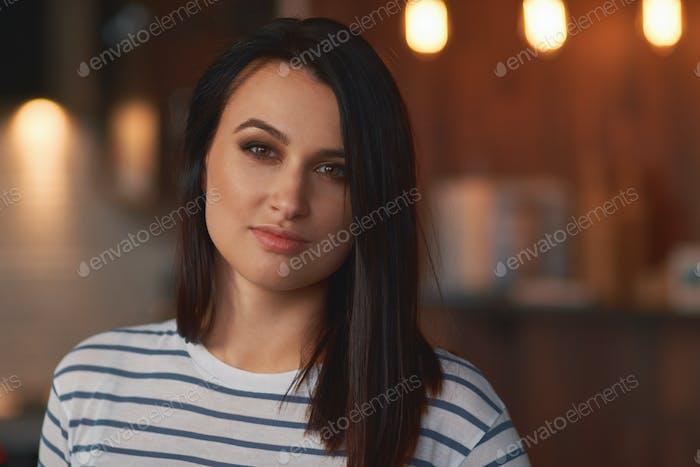 Close up portrait brunette girl at home