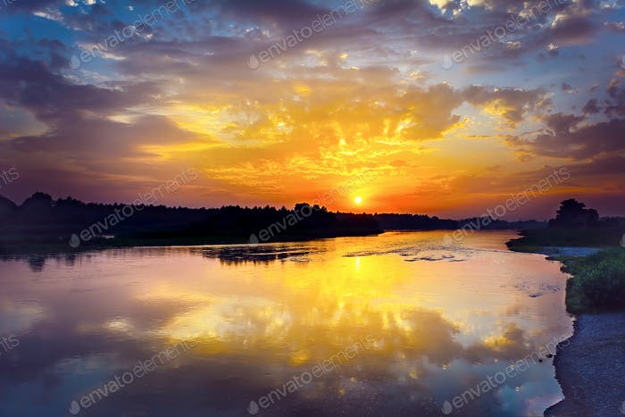 Summer river landscape with multicolored sunrise