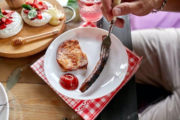 Enjoying dinner man eat meat, dinner table, appetizers variety serving