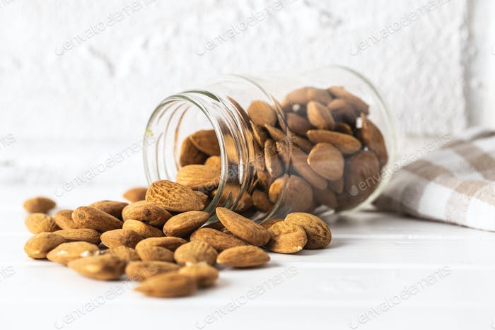 Dried almonds nuts in jar