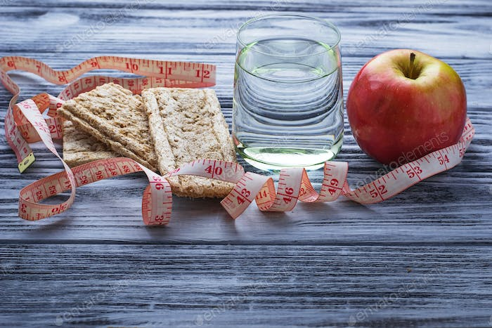 Concept of diet food: water, apple, crispbread