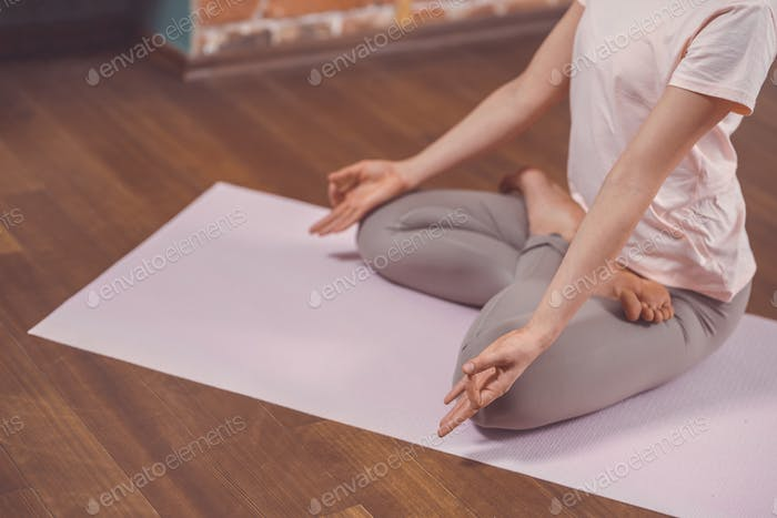Young girl in lotus pose