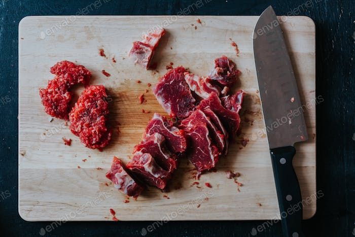 Chopped meat on cutting board