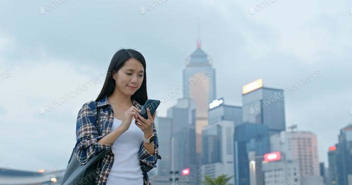 Woman use of mobile phone in city
