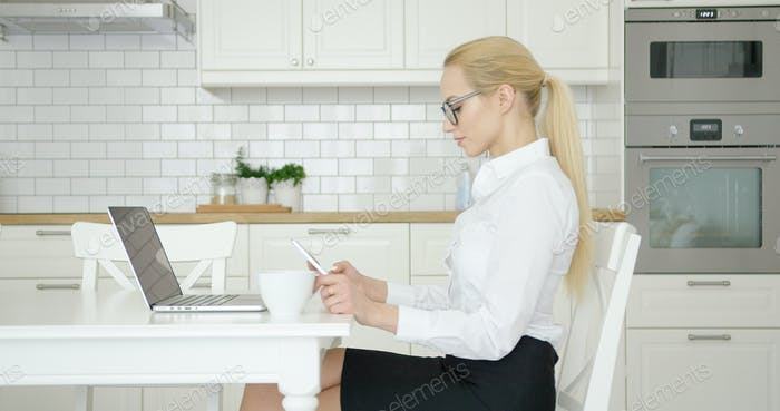 Confident woman working at home
