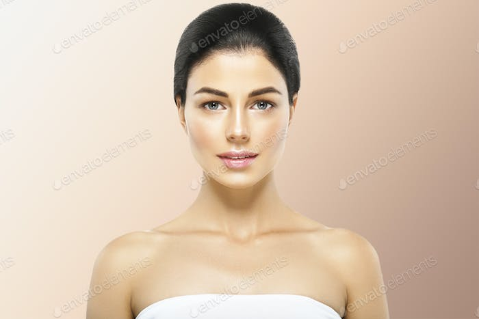 Woman cosmetic closeup beauty portrait healthy care skin and hair over beige color background