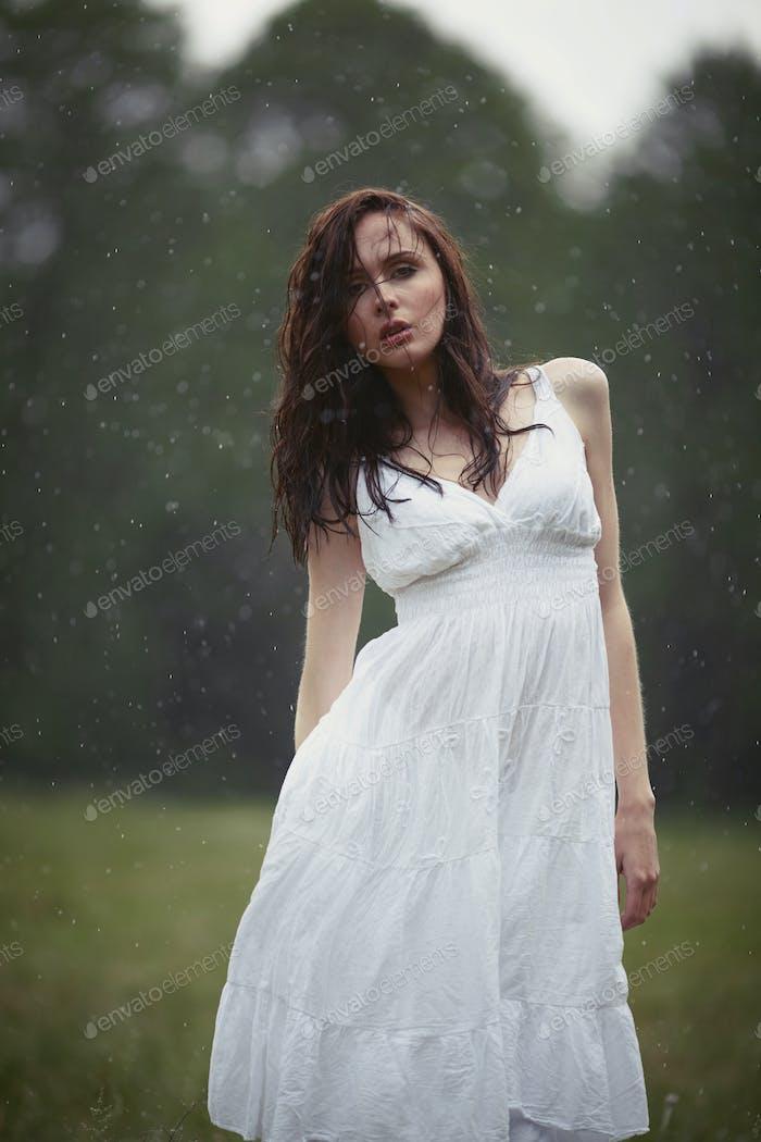 beautiful girl under rain