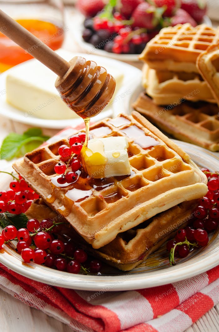 Belgian waffles served with butter red currants and honey