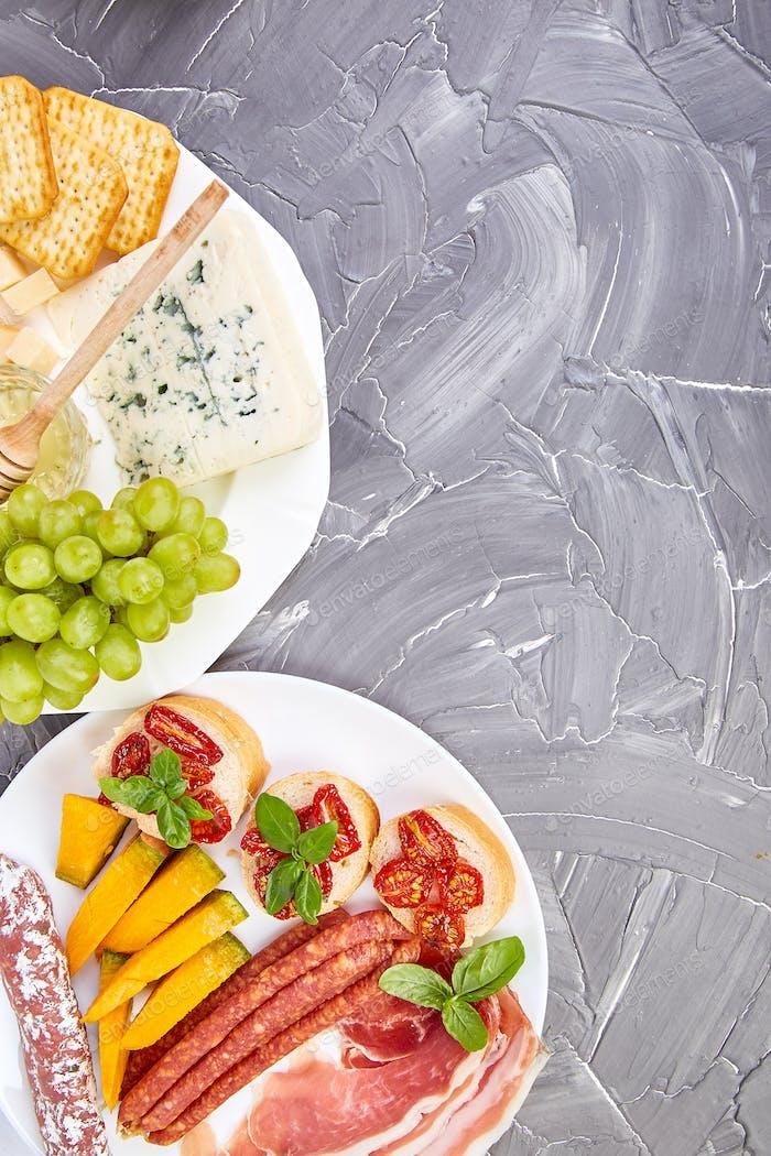Italian antipasti wine snacks set. Antipasto with jerky, salami,