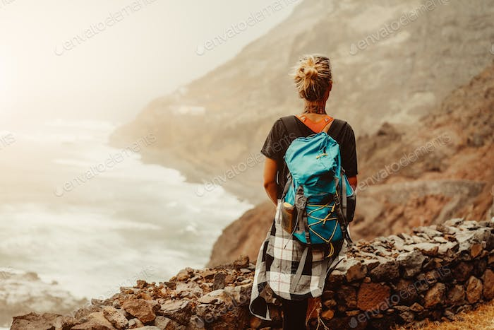 Santo Antao Island, Cape Verde. Tourist female enjoying view of rugged coastline on hiking route