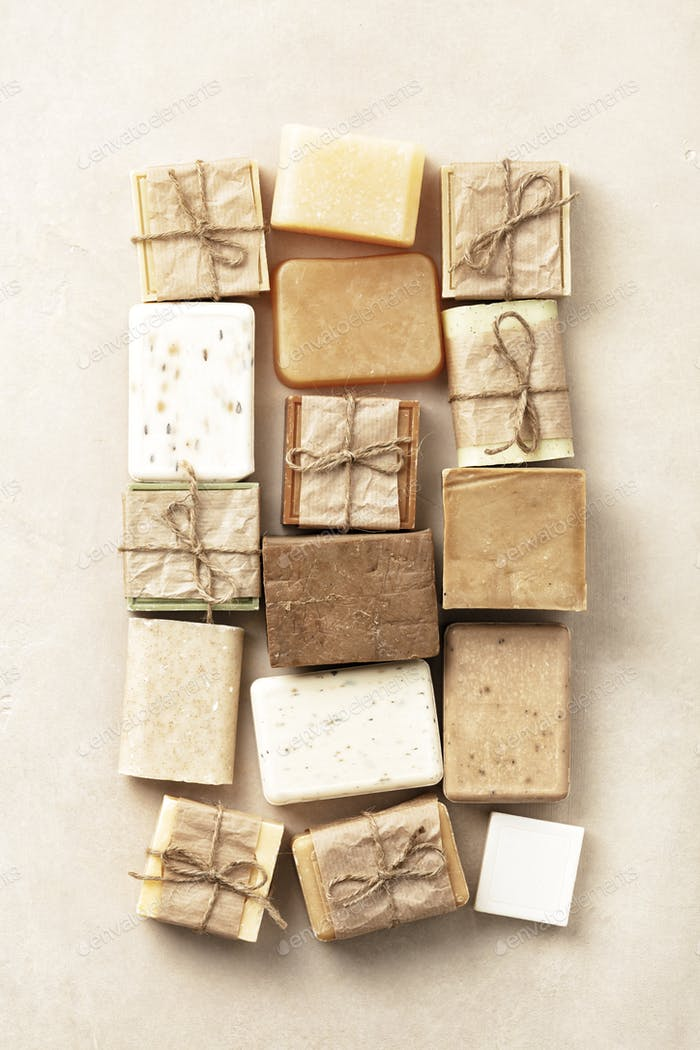 Flat lay composition with handmade soap bars on beige background
