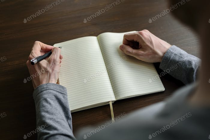 Writing by left hand in planner