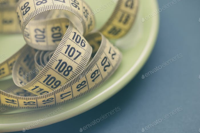 Tape measure in a plate