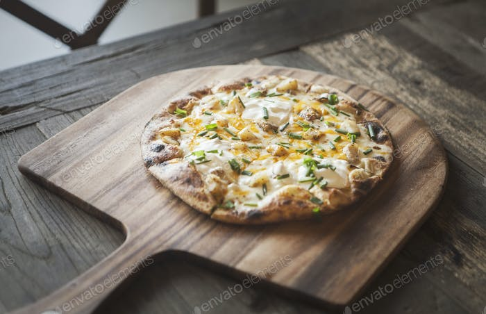 Pizza on a Wooden Board